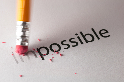 pencil erasing part of the word impossible